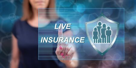 Woman touching a life insurance concept on a touch screen with her finger Stock Photo