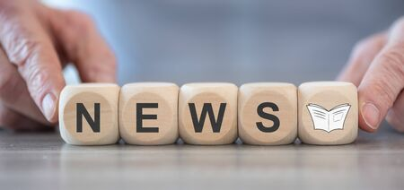 Concept of news on wooden blocks
