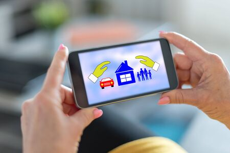 Smartphone screen displaying a family, home and car insurance concept