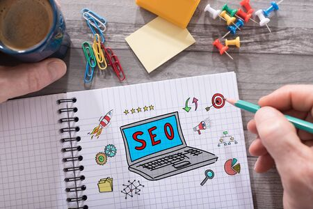 Seo concept drawn on a notepad placed on a desk