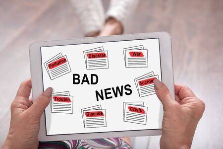 Bad news concept shown on a tablet held by a woman