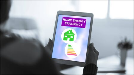 Tablet screen displaying a home energy efficiency concept Stock fotó