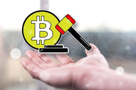 Bitcoin regulation concept above a hand of a man Stock Photo
