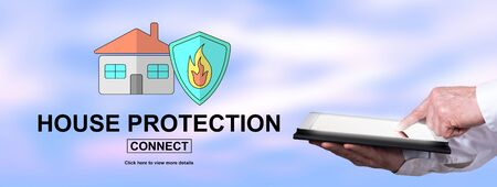 Finger pointing on digital tablet with house protection concept on background