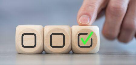 Concept of validation on wooden blocks Stock Photo