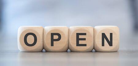 Word open on wooden blocks Reklamní fotografie