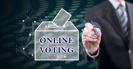 Man touching an online voting concept on a touch screen with a stylus pen 스톡 콘텐츠