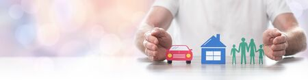 Family, house and car protected by hands - Concept of life, home and auto insurance - Panoramic banner Stock Photo