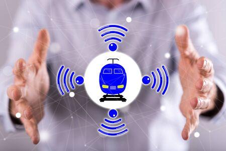 Smart train concept between hands of a man in background Stock fotó