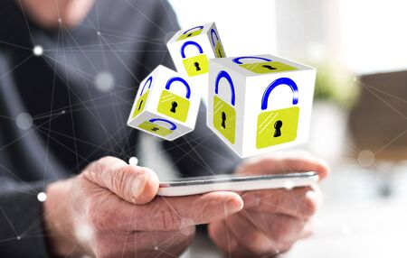 Hands of man holding a smartphone with data security concept Stock Photo