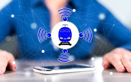 Smartphone with smart train concept between hands of a woman in background