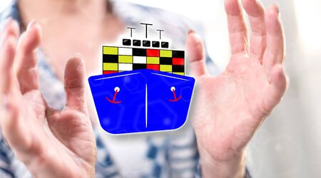 Maritime transportation concept between hands of a woman in background