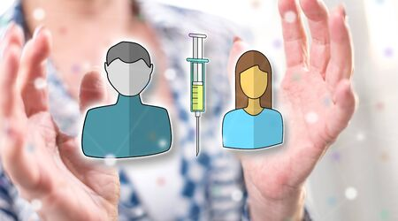 Vaccination concept between hands of a woman in background