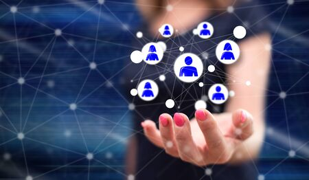 Social network concept above the hand of a woman in background Stock Photo