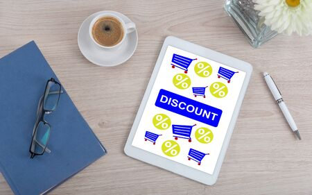 Top view of a desk with discount concept on a digital tablet