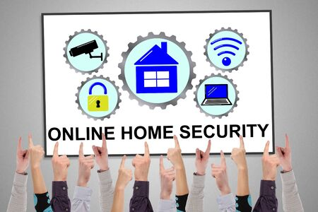Online home security concept on a whiteboard pointed by several fingers