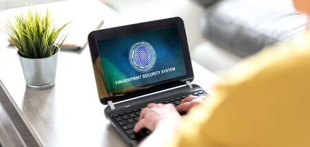 Laptop screen displaying a fingerprint security system concept Фото со стока