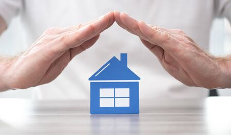 House protected by hands - Concept of home insurance Stock fotó