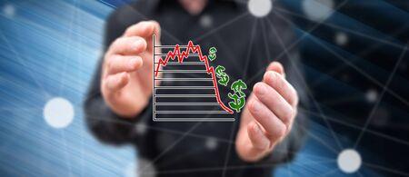 Stock market crash concept between hands of a man in background
