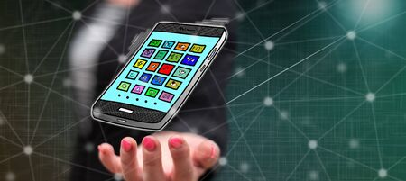 Apps concept above the hand of a woman in background