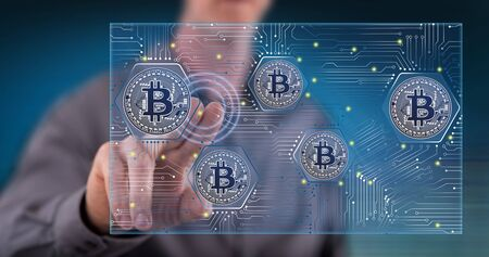 Man touching a bitcoin concept on a touch screen with his finger 写真素材