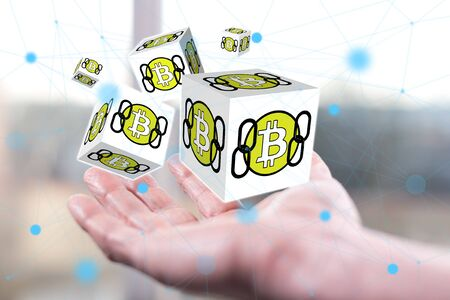 Bitcoin concept above a hand of a man 写真素材