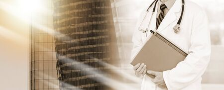 Doctor standing and holding a folder; multiple exposure Stok Fotoğraf