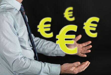 Euro concept above the hands of a man Stock Photo