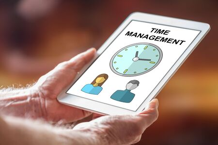 Man holding a tablet showing time management concept