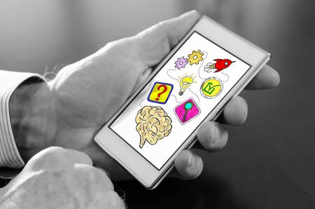 Hand holding a smartphone with problem solving concept Stockfoto