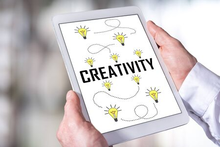 Man holding a tablet showing creativity concept