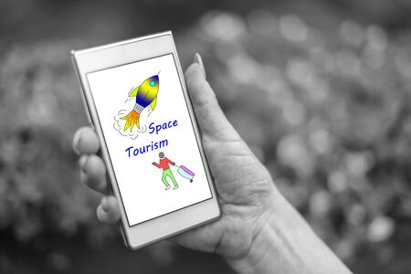 Female hand holding a smartphone with space tourism concept