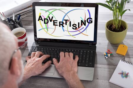 Advertising concept shown on a laptop used by a man