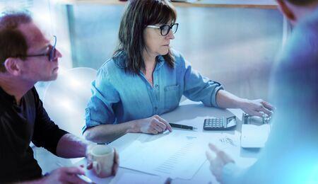 Business people working together in office; multiple exposure Banco de Imagens