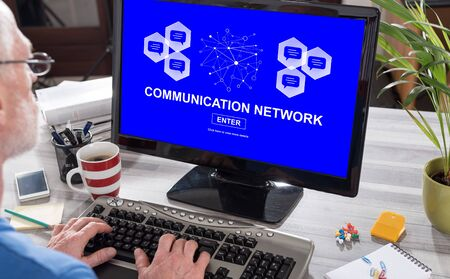 Man using a computer with communication network concept on the screen