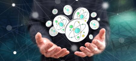 Nuclear research concept above the hands of a man in background
