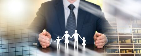 Insurer protecting a family with his hands; multiple exposure Stock Photo