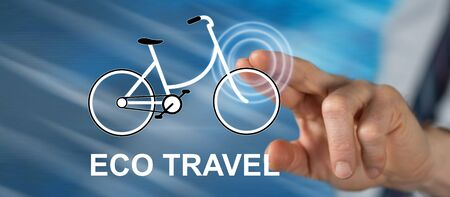 Man touching an eco travel concept on a touch screen with his finger