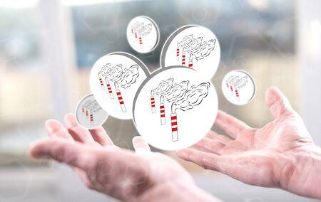 Air pollution concept above the hands of a man Banco de Imagens