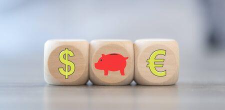 Concept of money saving on wooden blocks