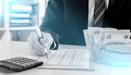 Businessman making investment calculations; light effect Banco de Imagens - 131264608