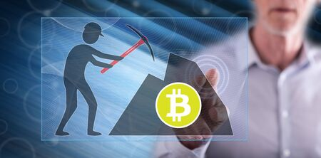 Man touching a bitcoin mining concept on a touch screen with his finger