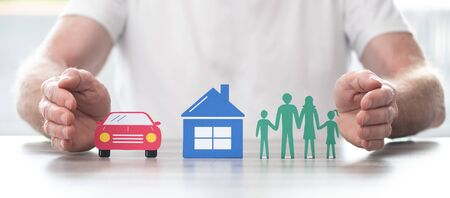 Family, house and car protected by hands - Concept of life, home and auto insurance Stockfoto