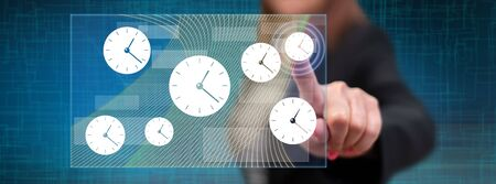 Woman touching a time management concept on a touch screen with her finger