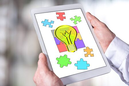 Man holding a tablet showing idea concept Stock Photo