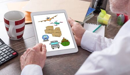 Transportation concept shown on a tablet held by a man Foto de archivo