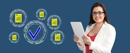 Woman using digital tablet with document validation concept on background Stok Fotoğraf