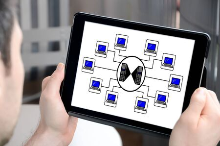 Man holding a tablet showing hosting concept Stock Photo