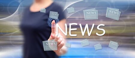 Woman touching a news concept on a touch screen with her finger