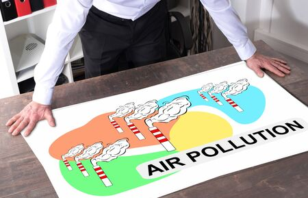Man watching an air pollution concept placed on a desk Banco de Imagens